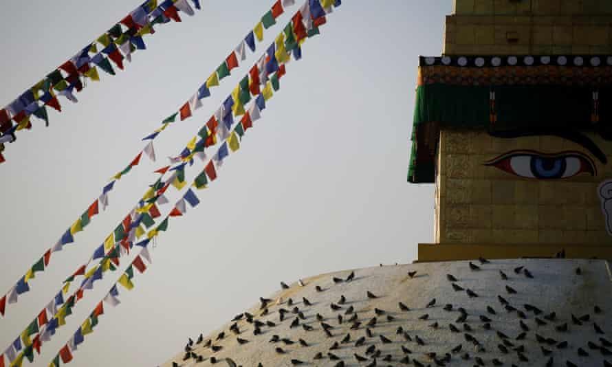 Pigeons rest on the Boudhanath stupa.