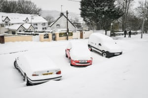 Cars covered in snow in Merthyr Tydfil, Wales.