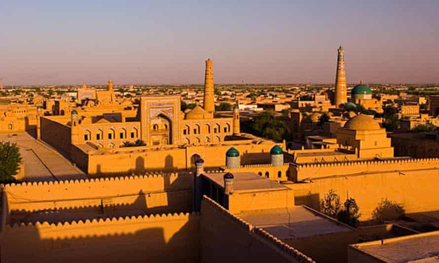 The mud brick city of Khiva at sunset.