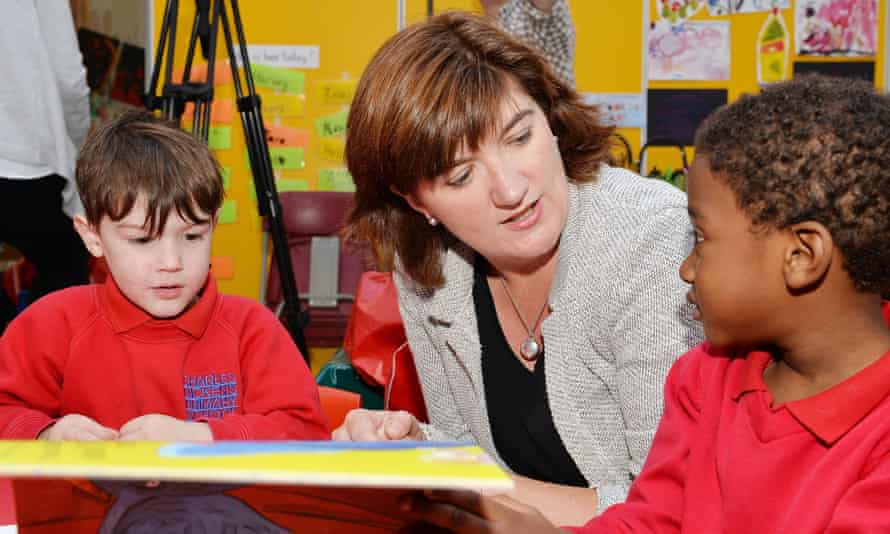Nicky Morgan, the education secretary reading with schoolchildren