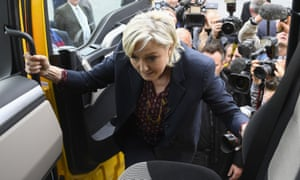 Marine Le Pen climbs into the cab of a lorry during her visit to the haulage company in Dol-de-Bretagne.