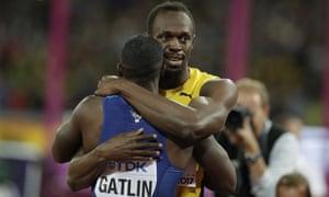 Usain Bolt hugs Justin Gatlin.