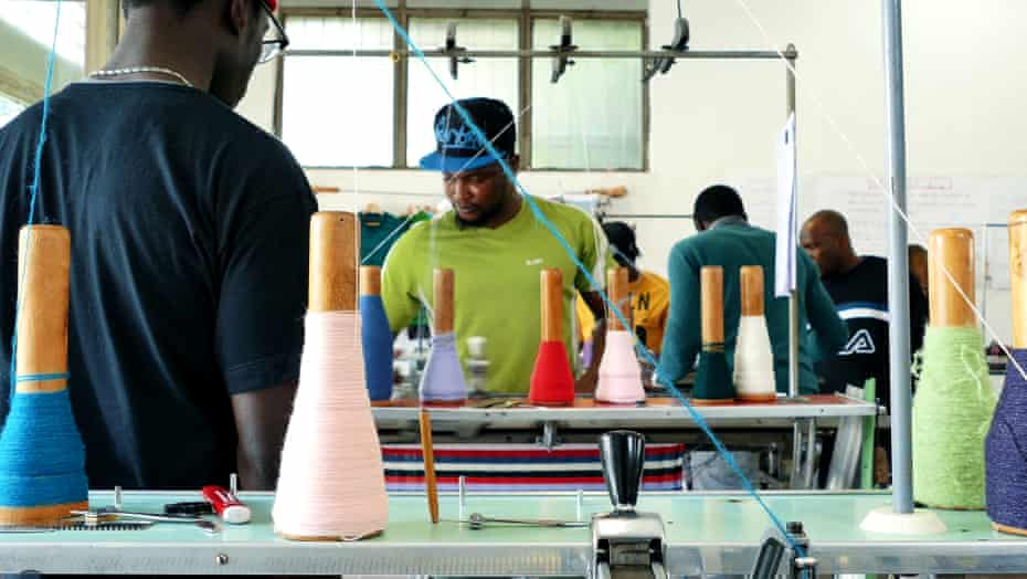 Workers training on knitting at the Manusa co-operative in Pistoia, Italy, which supports and teaches vulnerable people