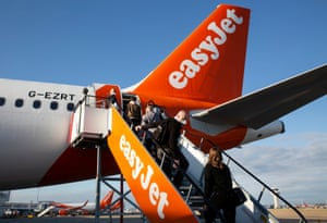 People boarding a easyJet aircraft.
