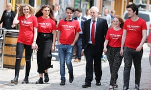 Jeremy Corbyn walks with students at an election rally in Hull.