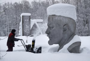 Razliv Lake, RussiaA worker clears snow next to the snow covered statue of Soviet Union founder Vladimir Lenin at the Lenin Hut Museum in a forest outside St. Petersburg.