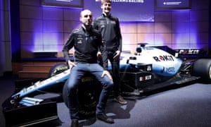Robert Kubica (left) and George Russell show off the Williams FW42 with this year's change of livery.