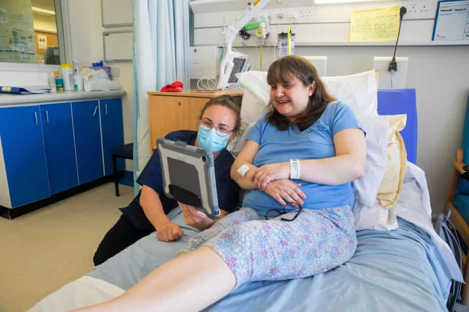 Heather Healey is shown how to make a video call to her son, James, using one of the hospital's iPads.