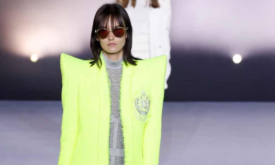 A model presents a creation by Balmain during Paris fashion week's women spring/summer 2021 ready-to-wear show.