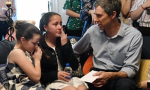 Katie Rosenblum, 12, comforts her friend Karola Garcia, 11, who wipes away tears as she gives a letter to and speaks with Beto O'Rourke during O'Rourke's meet-and-greet with the Mujeres Network at a home in Las Vegas.
