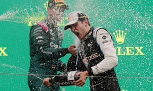 First placed Esteban Ocon of Alpine and second placed Sebastian Vettel of Aston Martin celebrate on the podium.