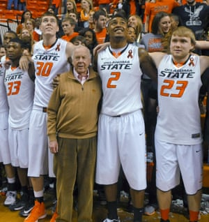 Pickens, center, celebrates with Oklahoma State's basketball team in 2013 following the team's win over Texas.