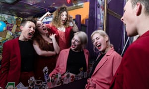 Anya Pearson (guitar and backing vocals); Janey Starling (lead vocals); Lucy Katz (drums); front pink suit: Mimi Jason (bass & backing vocals).