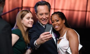 Richard E Grant takes a selfie with Amy Adams and Regina King at the Oscar nominees lunch, 4 February 2019.