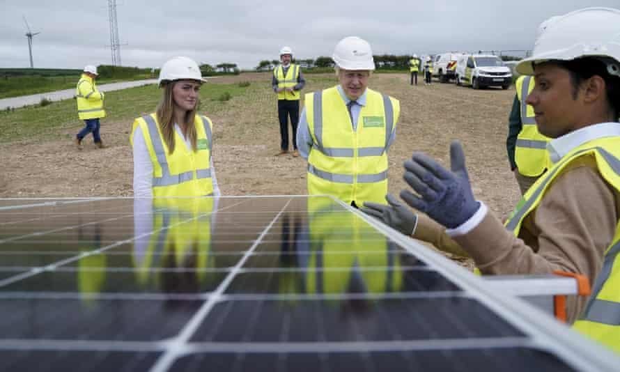 Boris Johnson views a solar panel at ScottishPower's Carland Cross wind farm in Newquay, Cornwall.