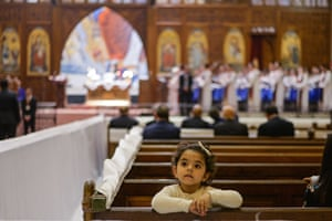Egyptian Coptic Christians pray during an Easter mass led by Pope Tawadros II of Alexandria in Cairo.