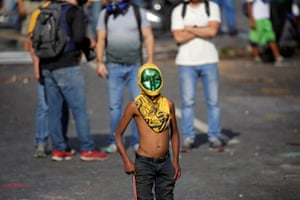 Caracas, VenezuelaA demonstrator wearing a mask looks on during a rally against President Maduro in Caracas