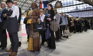 Delegates queue to get into the hall to hear David Cameron's speech at the Conservative conference.