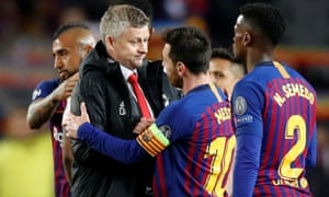 Manchester United manager Ole Gunnar Solskjær embraces Barcelona's Lionel Messi after the match.