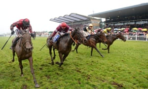 General Principle, second left, puts in a last effort before winning the Irish Grand National at Fairyhouse.