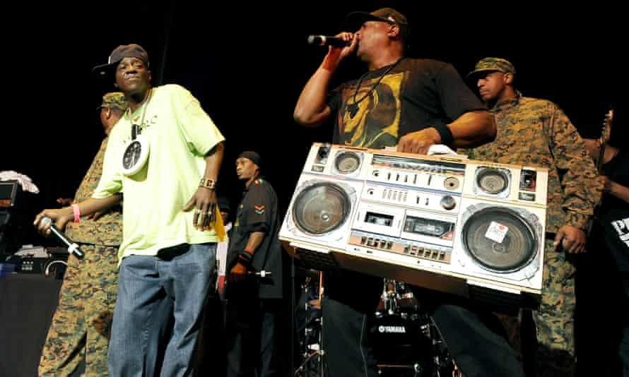 Flavor Flav (left) and Chuck D (with the large boombox) perform at Yoshi's nightclub in San Francisco in January 2011.