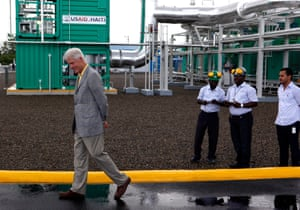 Former US president Bill Clinton visiting a new power plant in Caracol, Haiti, in 2012