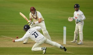 Craig Overton of Somerset plays a shot as Ryan Ten Doeschate of Essex attempts to field the ball.