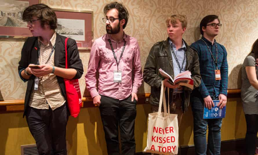 Members wait outside the Young Labour annual reception at the party conference.