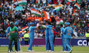India's Jasprit Bumrah celebrates taking the wicket of Bangladesh's Mustafizur Rahman to win the match by 28 runs.