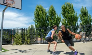 Two men play a casual game of basketball