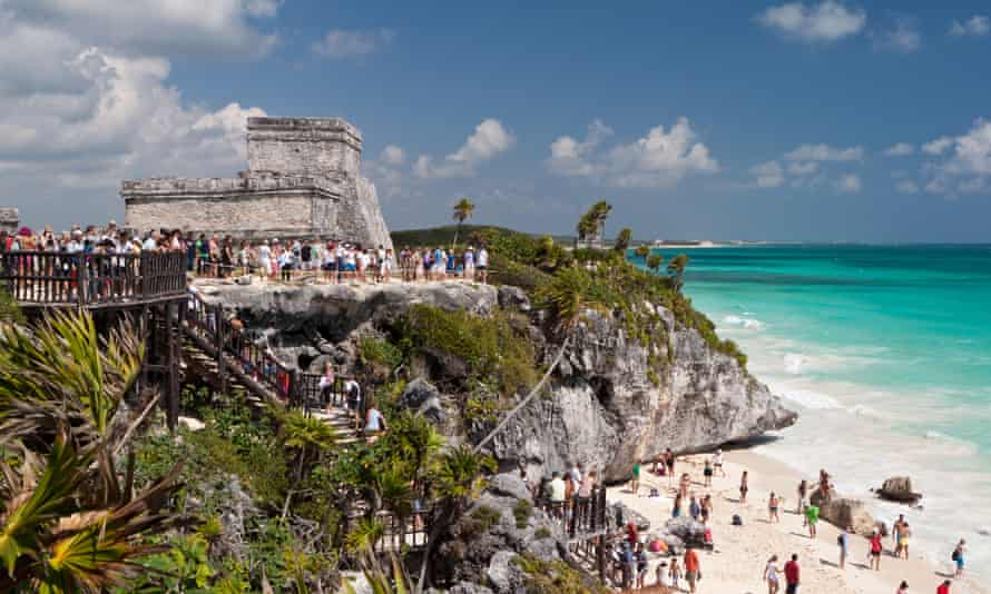 A huge crowd of tourists visits the ancient Mayan Ruins near the Caribbean sea in Tulum.