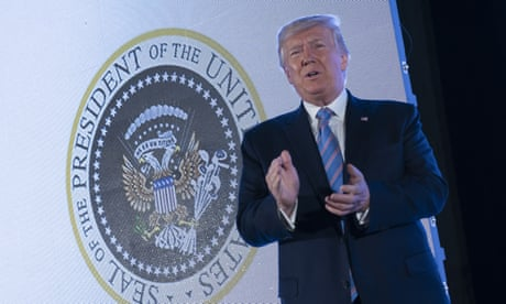 Trump speaks before presidential seal doctored with symbols of Russia and golf