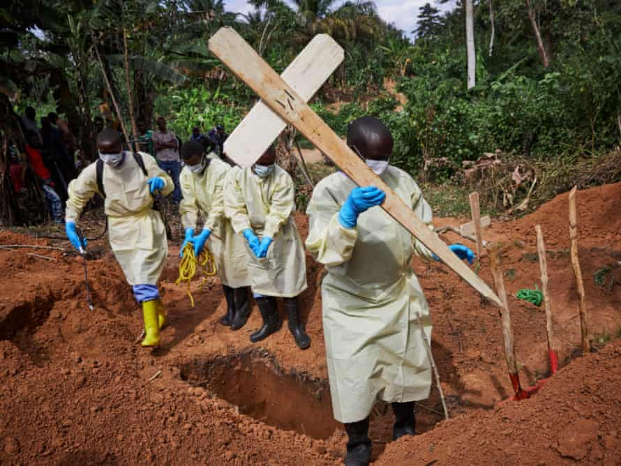 Health workers undertaking the burial of an 11-month-old child, Bunzi, in Beni, North Kivu province, DRC on 5 May 2019.