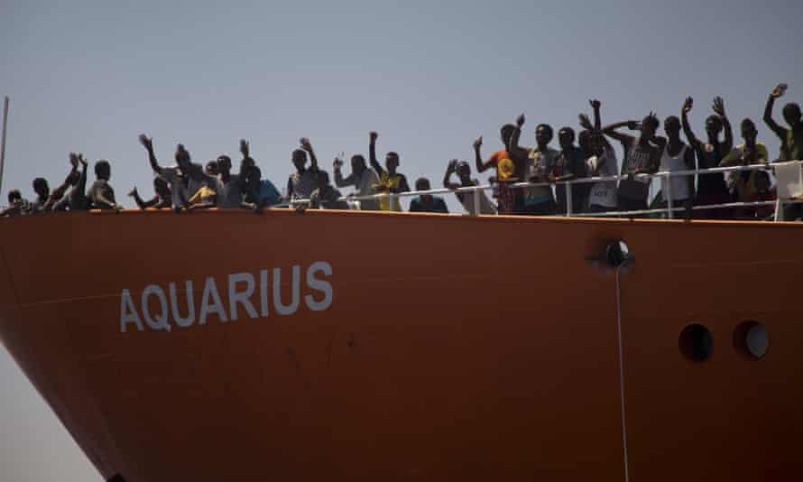Migrants wave from the Aquarius during an earlier rescue operation.