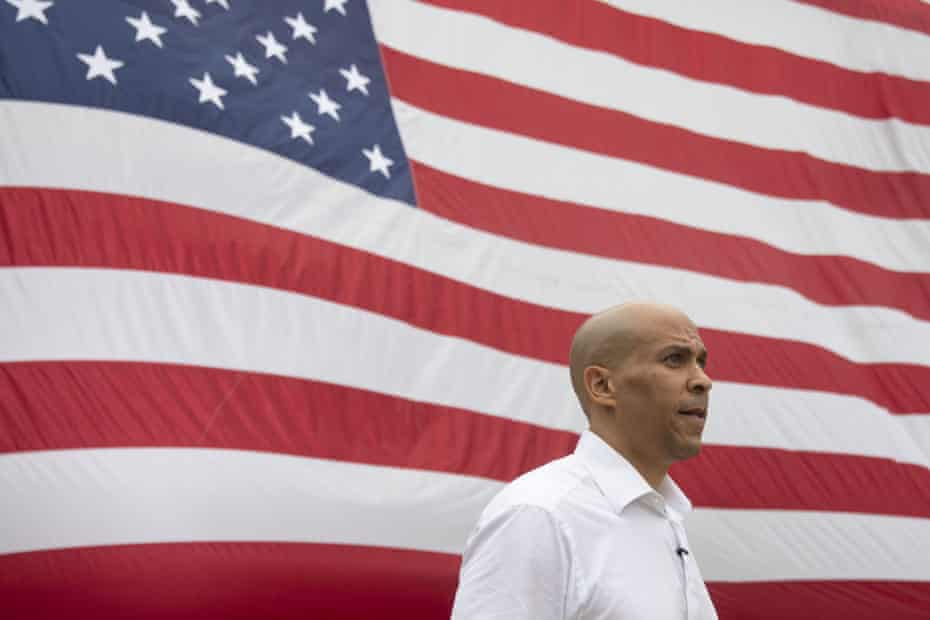 Senator Cory Booker, a Democrat from New Jersey and 2020 presidential candidate, walks towards the stage before speaking at the Polk County Steak Fry in Des Moines, Iowa.