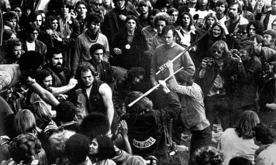 Hell Angels attacking Rolling Stones fans at the Altamont music festival.