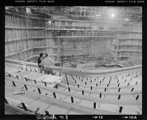 Two workmen survey the concert hall from the stalls (Nov 1979), which can hold nearly 2000 people.