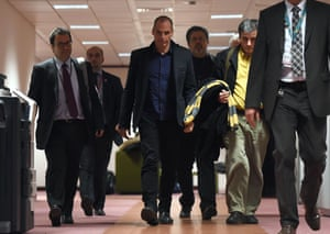 Greek Finance Minister Yanis Varoufakis (C) heads to a press conference on February 16, 2015 at the end of an Eurogroup finance ministers meeting at the European Council in Brussels.