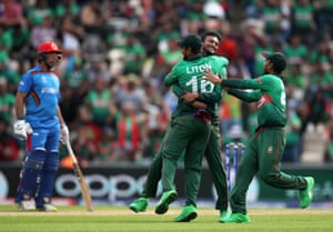 Shakib Al Hasan celebrates after taking the wicket of Afghanistan's Gulbadin Naib.
