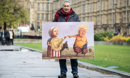 Political artist Kaya Mar shows a US election-themed artwork at College Green, Westminster.