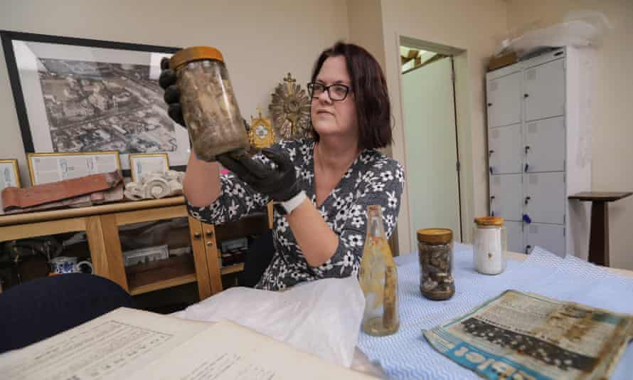 Archivist Triona Doocey goes through some of the relics unearthed during demolition of the Catholic cathedral in Christchurch, New Zealand