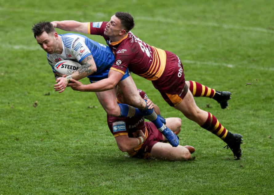 Leeds Rhinos' Richie Myler is tackled by Huddersfield Giants' Owen Trout and Oliver Wilson during their friendly match earlier this month.