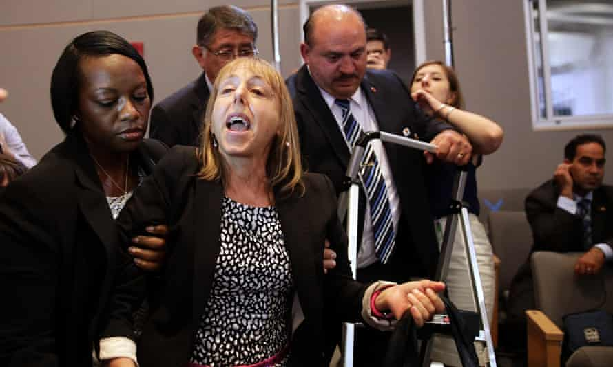 Medea Benjamin, being ejected from Obama's talk at the National Defense University, Washington, in 2013.