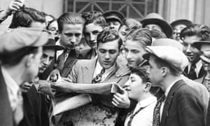 Messengers from brokerage houses crowd around a hard-to-obtain newspaper after the first Wall Street stock market crash on 24 October 1929