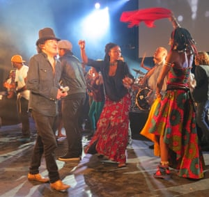 Rachid Taha, left, on stage in Marseille, France, with Fatoumata Diawara and Africa Express in 2013.