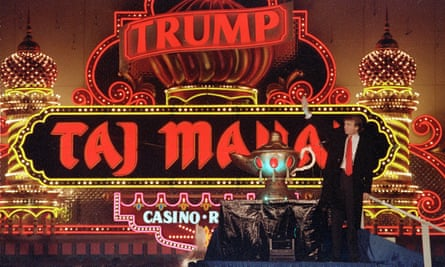 Donald Trump stands next to a genie lamp at the opening of the casino in 1990.