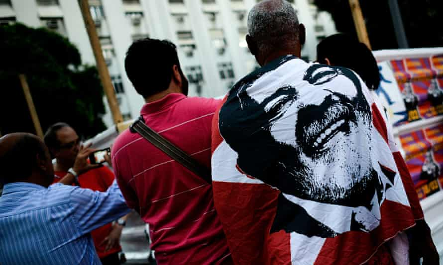 Workers' party supporters demonstrate for current Rousseff and Lula in March