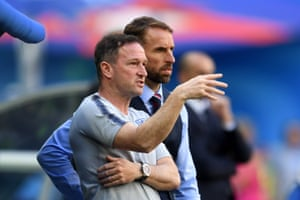 England assistant manager Steve Holland and Gareth Southgate discuss tactics.