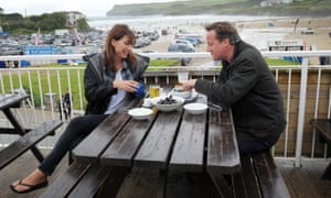 Former prime minister David Cameron and his wife Samantha having lunch at Polzeath. The couple have recently bought a home in Cornwall.
