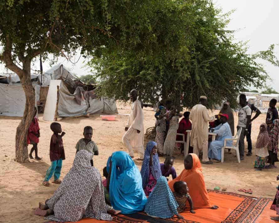 CHAD. August 2017. Dar es Salaam. Families of Nigerian refugees wait for their turn to make a phone call.